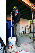 WMG staffer Nichole Casebeer mixes the elastomeric coating that volunteers will apply to my cistern. It will serve as the primer.