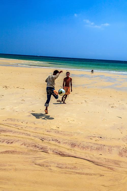 Children are playing football in Diani beach, Kenya.