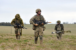 © Licensed to London News Pictures. 09/03/2012. Copedown Hill, UK.  Soldiers on a patrol exercise. Secretary of Defence Philip Hammond visits troops during the day. The 12thMechanized Brigade (12 Mech Bde) at Copehill Down, Salisbury Plain Training Area, Wiltshire,on FRIDAY 09 MARCH 2012, as it prepares to deploy to Helmand Province, Afghanistan, on Operation Herrick 16, in the Spring of this year. The Brigade were performing a dynamic demonstration of combined Afghan/ISAF operations supported by surveillance assets and casualty evacuation capability. Tornado GR4 fast jest ground support was also displayed.. Photo credit : Stephen SImpson/LNP