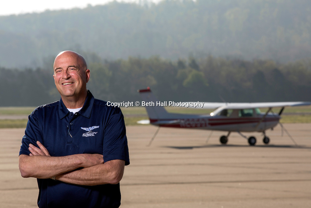 Mark Frakum with SkyVenture Aviation stands at Drake Field on Tuesday, April 22, 2014, in Fayetteville, Ark.