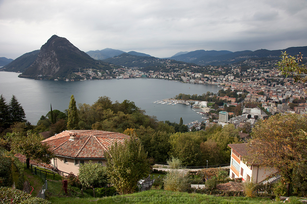"""Lugano, Switzerland on Lake Lugano.""""Lugano is a city in the south of Switzerland, in the Italian-speaking canton of Ticino, which borders Italy. The population of the city proper was 55,151 as of December 2011, and the population of the urban agglomeration was over 145,000. Wikipedia"""""""