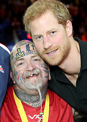 Prince Harry meets Paul Guest at the wheelchair basketball at the Mattamy Athletic Centre at the 2017 Invictus Games in Toronto, Canada.