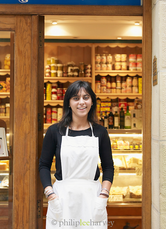 A young woman who works at a small, local delicatessan in San Sebastian, Spain