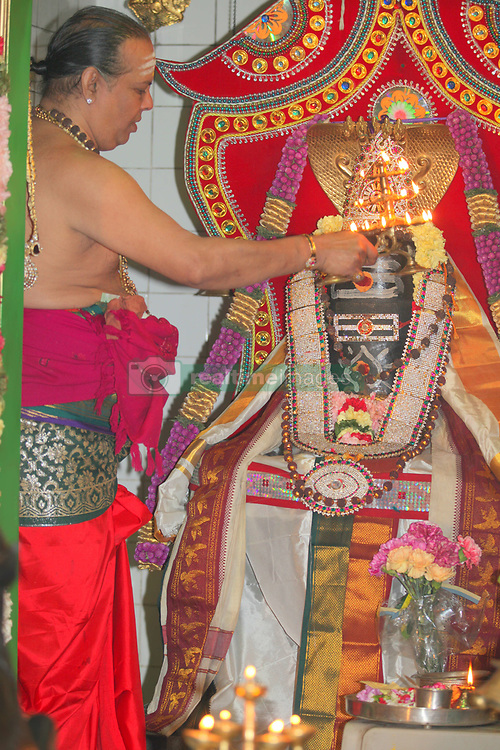 May 20, 2017 - Toronto, ONTARIO, Canada - Tamil Hindu priest performs special prayers honoring Lord Shiva at a Tamil Hindu temple in Ontario, Canada. (Credit Image: © Creative Touch Imaging Ltd/NurPhoto via ZUMA Press)