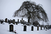 The grave yard in Stow is covered in fresh snow on the 21st of January 2021, the Scottish Borders, United Kingdom. The grave yard is on a hill a short walk out of the village Stow and goes back centuries. The winter snow covers graves and paths making it hard to see where the graves start and stop.