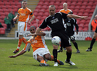 Photo: Paul Thomas.<br /> Blackpool v Swansea City. Coca Cola League 1. 15/04/2006.<br /> <br /> Swansea's Lee Trundle is tackled by Marc Joseph.