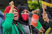 """An Afghan woman shouts anti-Taliban slogans during a protest """"Save Afghanistan"""" near Marble Arch in central London against the Taliban on Saturday, Aug 21, 2021. (VX Photo/ Vudi Xhymshiti)"""