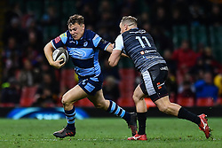 27th April 2019 , Principality Stadium , Cardiff, Wales ; Guinness pro 14's, Round 21, Cardiff Blues Vs Ospreys ; Jarrod Evans of Cardiff Blues evades the tackle of Hanno Dirksen of Ospreys<br /> <br /> Credit :  Craig Thomas/Replay Images