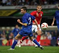 Photo: Chris Ratcliffe.<br /> England U21 v Moldova U21. European Championship Qualifier. 15/08/2006.<br /> David Bentley of England U21 clips the ball past Vitalie Bordian of Moldova U21.
