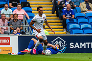 Bournemouth defender Lloyd Kelly (5) robs Cardiff City forward Kieffer Moore  (10) of the ball during the EFL Sky Bet Championship match between Cardiff City and Bournemouth at the Cardiff City Stadium, Cardiff, Wales on 18 September 2021.