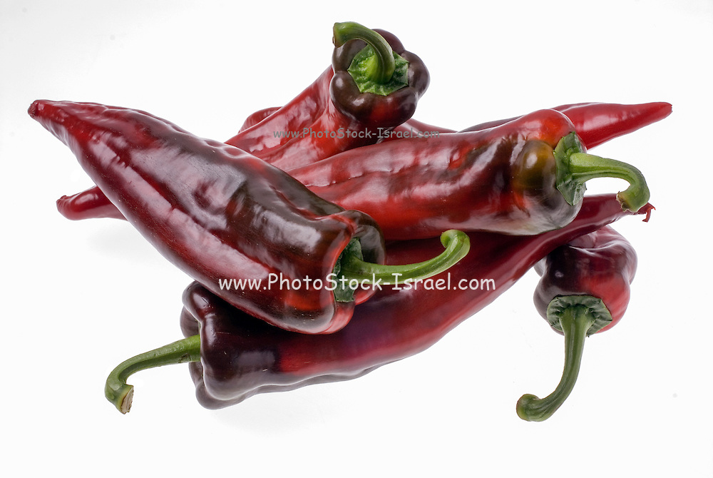 Red hot chilli peppers on white background