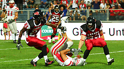 11.07.2011, UPC Arena, Graz, AUT, American Football WM 2011, Group B, Canada (CAN) vs Austria (AUT), im Bild touchdown by Jakob Dieplinger (Austria, #1, WR), Troy Adams (Canada, #21, DB) and Bryce McCall (Canada, #23, DB) cannot stop him  // during the American Football World Championship 2011 Group B game, Canada vs Austria, at UPC Arena, Graz, 2011-07-11, EXPA Pictures © 2011, PhotoCredit: EXPA/ T. Haumer