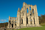 Rievaulx Abbey. North Yorkshire, England . Rievaulx Abbey was a Cistercian abbey in Rievaulx, situated near Helmsley in the North York Moors National Park, North Yorkshire, England. Rievaulx Abbey was one of the great abbeys in England until it was seized under Henry VIII of England in 1538 during the dissolution of the monasteries. Founded in 1132 by twelve monks from Clairvaux Abbey. Rievaulx Abbey remote location was well suited to the order's ideal of a strict life of prayer and self-sufficiency with little contact with the outside world. <br /> <br /> Visit our MEDIEVAL PHOTO COLLECTIONS for more   photos  to download or buy as prints https://funkystock.photoshelter.com/gallery-collection/Medieval-Middle-Ages-Historic-Places-Arcaeological-Sites-Pictures-Images-of/C0000B5ZA54_WD0s