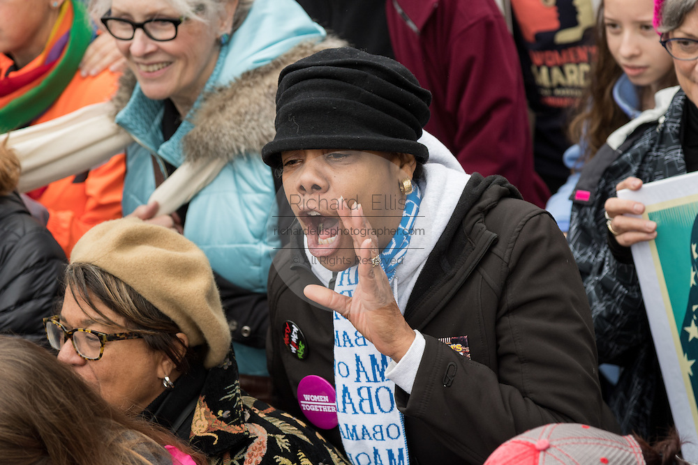 Demonstrators shout slogans during the Women's March on Washington in protest to President Donald Trump January 21, 2017 in Washington, DC. More than 500,000 people crammed the National Mall in a peaceful and festival rally in a rebuke of the new president.