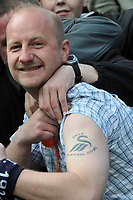 Photo: Tony Oudot/Richard Lane Photography. <br /> Gilingham Town v Swansea City. Coca-Cola League One. 12/04/2008. <br /> A Swansea fan shows off his tattoo