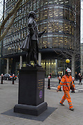 A workman walks past the statue of Member of parliament and Mayor John Wilkes (1727-1797) on 9th February 2017, in the City of London, England.