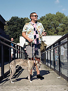 A man with a whippet dog during the Dulwich Hamlet Vs Hampton & Richmond Borough game on the 1st September 2018 at the KNK Stadium in South London in the United Kingdom. The KNK Stadium is Dulwich Hamlets temporary ground following eviction from their home ground, Champion Hill in March 2018.