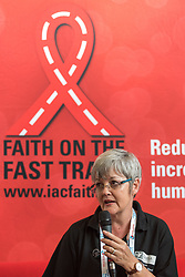 """26 July 2018, Amsterdam, the Netherlands: """"We ask 'what have we done, to deserve this', and we also ask ,'what have we done, or not done, about sexual and gender-based violence?'"""" - Lyn van Rooyen leads morning prayers in the Interfaith Networking Zone, on the theme of """"Faith against Gender based violence - Thursdays in Black"""". On 23-27 July 2018 in Amsterdam, the Netherlands, the World Council of Churches - Ecumenical Advocacy Alliance in collaboration with faith and other partners hosts an Interfaith Networking Zone in the International AIDS Conference's Global Village area, providing a dynamic space for exchanges, resources and workshops. The Global Village is an integral part and recurring feature of the International AIDS Conference, and offers an accessible venue intended to strengthen the connection between the international conference and the local hosting community."""