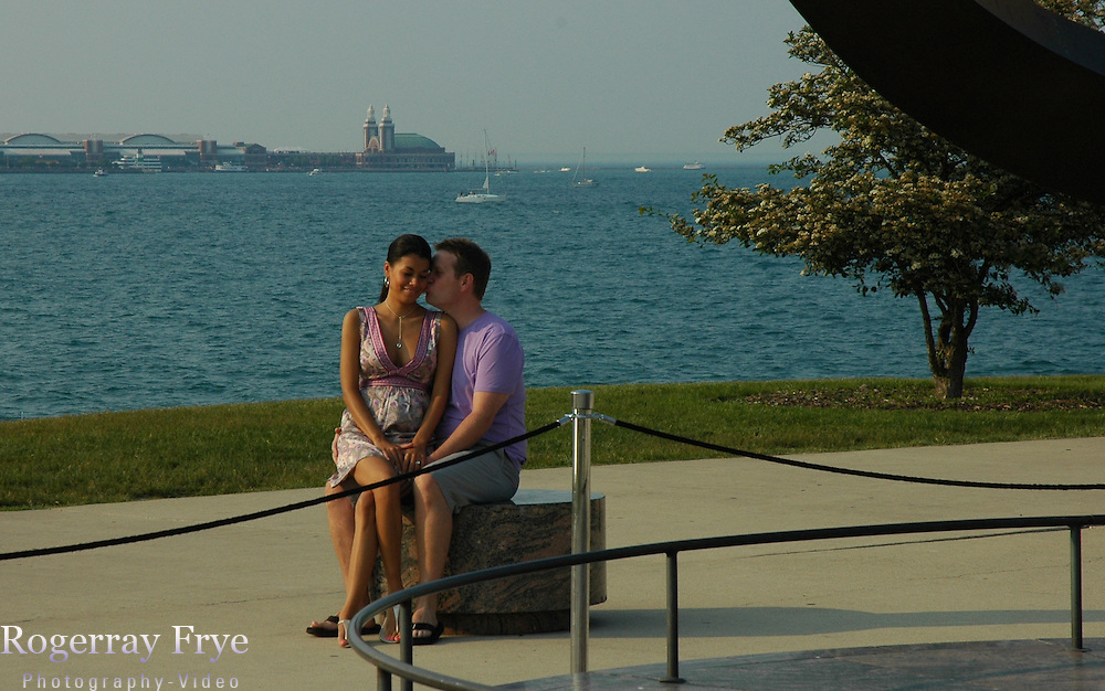 This is James and Olga's Engagement photos in Chicago, Illinois. This was so fun!  I love Chicago and since my Little Bother lives there we went thier to do the Engagement shoot. Memorial day on the trian and what a lovely weekend!  I do travel for photo shoots so call if you like what I do!  Cheers You two!!