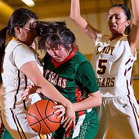 112113      Brian Leddy<br />  Wingate Bear Arlinda Lee (33) and Tohatchi Cougar Trisverlyn Bilk (14) struggle for the ball during Thursday's game in Tohatchi.