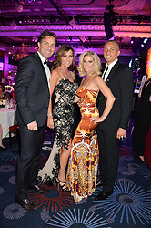 Left to right, ASHLEY & DAWN WARD and WES & LEANNE BROWN and at the Caudwell Children's annual Butterfly Ball held at The Grosvenor House Hotel, Park Lane, London on 15th May 2014.