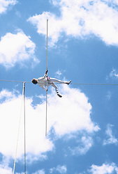 Man performing on tightrope