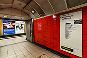 A sign in Green Park underground station shows amendments in a red pen which stations have been closed in an attempt to reduce the spread of coronavirus in London, Wednesday, April 8, 2020. (Photo/Vudi Xhymshiti)
