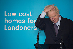 © licensed to London News Pictures. London, UK 25/11/2013. Mayor of London, Boris Johnson giving a speech on tackling London's housing needs on Monday, November 25, 2013 in Greenwich Square, London. Photo credit: Tolga Akmen/LNP