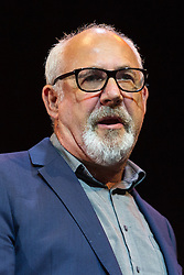 © Licensed to London News Pictures. 07/07/2016. LONDON, UK.  JON TRICKETT MP speaking at a rally in support of keeping Jeremy Corbyn remaining the Labour party leader at the Troxy in east London on 6th July 2016. The event was organised by Momentum, a group of Labour Party supporters who are campaigning for Jeremy Corbyn to remain as leader of the Labour Party, following the recent resignation of many shadow cabinet MP's and the growing likelihood of a Labour Party leadership challenge..  Photo credit: Vickie Flores/LNP