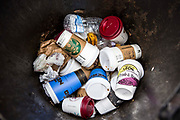 Coffee cups make up the majority of the contents of a street rubbish bin in central London.