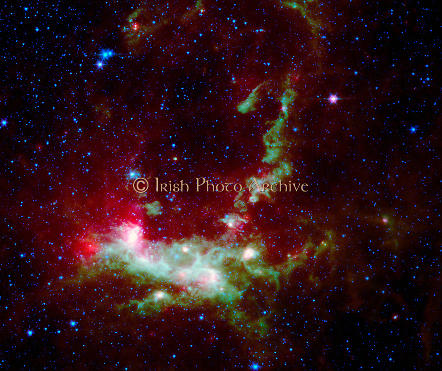 The LMC is a small satellite galaxy gravitationally bound to our own Milky Way. Yet the gravitational effects are tearing the companion to shreds. Spitzer Space Telescope.