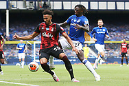 Bournemouth defender Lloyd Kelly (26) fends off the challenge from Everton forward Moise Kean (27) during the Premier League match between Everton and Bournemouth at Goodison Park, Liverpool, England on 26 July 2020.