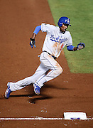 ATLANTA, GA - SEPTEMBER 02:  Shortstop Dee Gordon #9 of the Los Angeles Dodgers rounds third base on his way to scoring a run during the game against the Atlanta Braves at Turner Field on September 2, 2011 in Atlanta, Georgia.  (Photo by Mike Zarrilli/Getty Images)