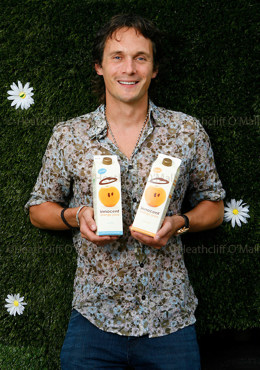Hal0005453 Daily Telegraph.Richard Reed one of the co-founders of Innocent drinks photographed with their new Orange Juice range due to be released soon.