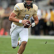 UCF Knights quarterback Blake Bortles (5) scrambles during an NCAA football game between the South Carolina Gamecocks and the Central Florida Knights at Bright House Networks Stadium on Saturday, September 28, 2013 in Orlando, Florida. (AP Photo/Alex Menendez)