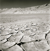 Cracked, dry earth in the desert outside Turpan, a town along the old Silk Route in China