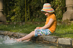 Gril (age 6) plays on edge of pool in garden of Dumbarton Oaks, Georgetown, Washington D.C. (District of Columbia), United States  MR