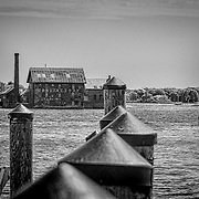 This is a wider view of the old Gloucester factory.  The main focus remains framed by the pilings, while the building on the right adds some perspective