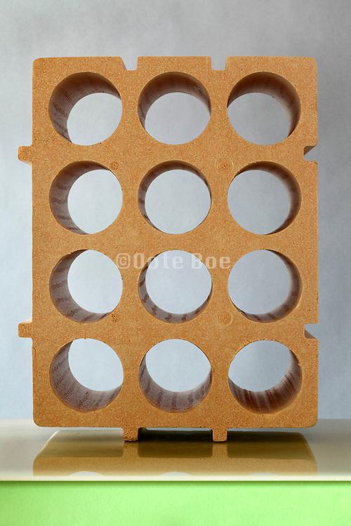 object still life with pressed styrofoam wine bottle rack