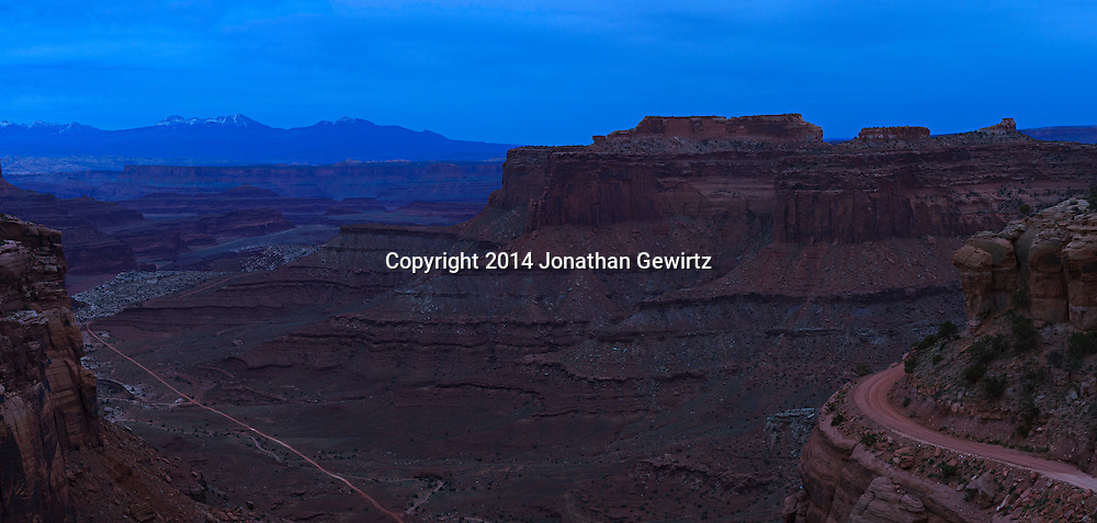 Panoramic view shortly after sunset of Shafer Canyon and Shafer Trail Road near the Canyonlands National Park visitor center. The LaSal Mountains are visible in the background. <br /> <br /> WATERMARKS WILL NOT APPEAR ON PRINTS OR LICENSED IMAGES.