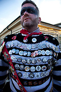 Lewes, UK. Monday 5th November 2012. Member of the Cliffe bonfire society with his badges for every year going back to 1980. Bonfire Night celebration in the town of Lewes, East Sussex, UK which form the largest and most famous Guy Fawkes Night festivities. Held on 5 November, the event not only marks the date of the uncovering of the Gunpowder Treason and Plot in 1605, but also commemorates the memory of the 17 Protestant martyrs from the town burnt at the stake for their faith during the Marian Persecutions of 1555–57. There are six bonfire societies putting on parades involving some 3,000 people.