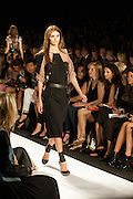 A black dress with beige lace accents at the BCBGMAXAZRIA show at the Spring 2013 Mercedes Benz Fashion Week show in New York.