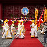 The ceremony processes in front of a stage of Communist Party officials.   <br /> <br /> Chinese folk religion was under assault by Chinese intellectuals, Christian missionaries and the Chinese government since the late Qing Dynasty. This oppression was particularly vicious under Mao who, rightly so, identified Chinese folk religious practices as the soul and core of traditional social structures, which he was intent on destroying and remaking into a communist utopia. In 1979, exhausted from the destructive excesses of the Cultural Revolution and deeming folk religion nearly obliterated, the government took a more indifferent attitude towards these traditional practices.