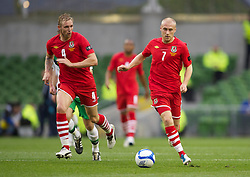 DUBLIN, REPUBLIC OF IRELAND - Friday, May 27, 2011: Wales' David Cotterill and Jack Collison in action against Northern Ireland during the Carling Nations Cup match at the Aviva Stadium (Lansdowne Road). (Photo by David Rawcliffe/Propaganda)