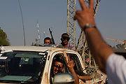 Sco0033837 .  Daily Telegraph..Rebel fighters pass a checkpoint in Tripoli. The vast majority of the city is now in the full control of the rebels...Tripoli 28 August 2011. ............Not Getty.Not Reuters.Not AP.Not Reuters.Not PA