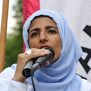 Speaker repesent Muslim Women rally at Whitehall against Tommy Robinson, Trump and the far-right at Old Palace Yard, London, UK. July 14 2018.