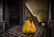 VENICE, FEBRUARY 2018. A model poses at the hystorical palace of Scuola Grande San Giovanni Evangelista, wearing a Zuava costume on February, 2018 in Venice, Italy. Carnival of Venice is also lived inside the palaces, and this selection of costumes, inspired by the Renaissance, keep the classical tradition of the Carnival of Venice, using Rubelli fabrics, silk, gold, silver and precious materials. All the costumes are made by Atelier Pietro Longhi.