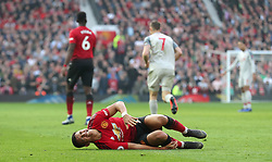 Manchester United's Alexis Sanchez lies injured on the pitch