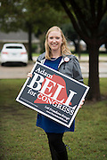 Emily Lawrence poses for a portrait in Plano, Texas on November 8, 2016. Emily voted for Hilary Clinton and supports her stance on women's rights. She is also supporting Adam Bell in his campaign for Congress based on his stances on congressional term limits and the fact that he is her brother. She has been campaigning for her brother outside a polling location in Plano through the rain all morning. (Cooper Neill for The Texas Tribune)