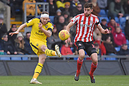 Oxford United forward Jamie Mackie (19)clears from Sunderland defender Jack Baldwin (15) during the EFL Sky Bet League 1 match between Oxford United and Sunderland at the Kassam Stadium, Oxford, England on 9 February 2019.